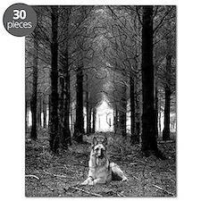 German Shepherd Dog sitting down in woods. Puzzle