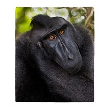 Crested black macaque Throw Blanket