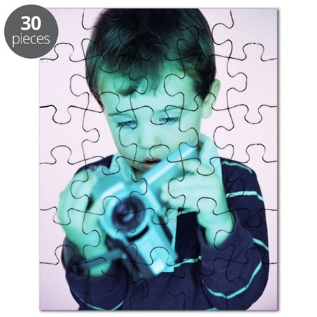 Boy with video camera Puzzle
