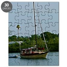 Small sailboat on blue water Puzzle