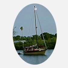 Small sailboat on blue water Oval Ornament
