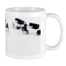 2 men shaking hands at office Coffee Mug