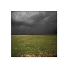 "Grassland with dark clouds Square Sticker 3"" x 3"""