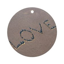The word Love spelled out in the sa Round Ornament