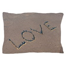 The word Love spelled out in the sand. Pillow Case
