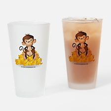 MGB - Monkey Sitting on Pile of Ban Drinking Glass