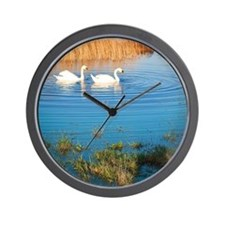 Swans on pond Wall Clock