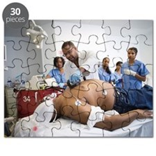 Doctor and nurses treating patient in emerg Puzzle