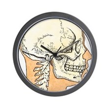 Illustration of skull and profile of ad Wall Clock