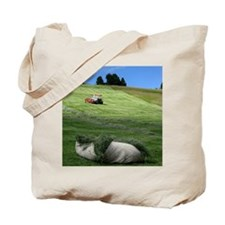 Tractor at grassland Tote Bag