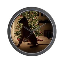 Great dane dog sitiing by Christmas tre Wall Clock