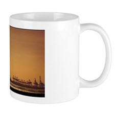 Bird flying over cranes in container te Coffee Mug