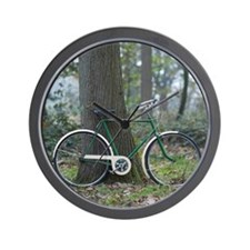 Green vintage bike leaning against tree Wall Clock