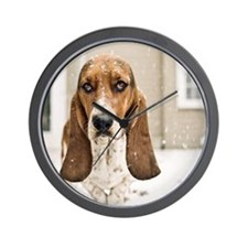 Basset hound in snow Wall Clock