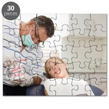 Dentist talking with girl in office Puzzle