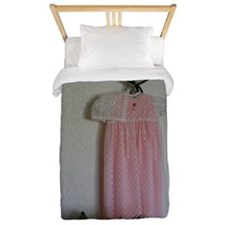 A christening gown hanging on a light f Twin Duvet