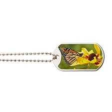 Monarch butterfly on yellow flower Dog Tags