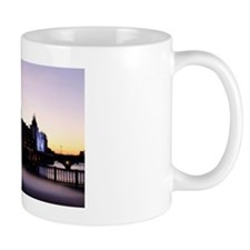 Silhouette of urban buildings at sunset Mug