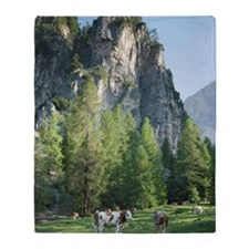 Cow Standing in Alpine Setting. Throw Blanket