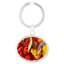 Peppers in a market in Lima, Peru Oval Keychain