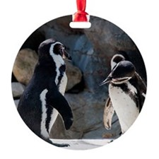 Two penguins standing looking at ea Ornament