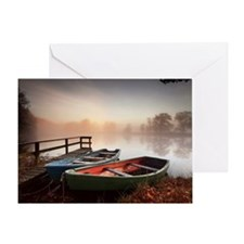 Rowing boats moored on banks of wood Greeting Card