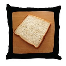 One bread slice on a table Throw Pillow