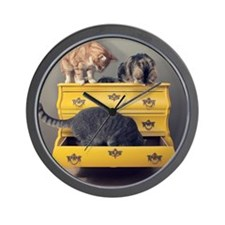 Cats and yellow cabinet Wall Clock
