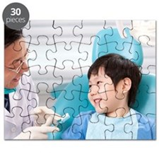 Dentist teaching the right way of brushing  Puzzle