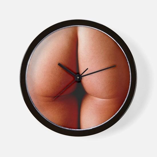 Nude man's buttocks Wall Clock