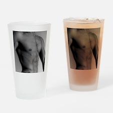 Nude man's torso Drinking Glass