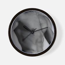 Nude man's torso Wall Clock