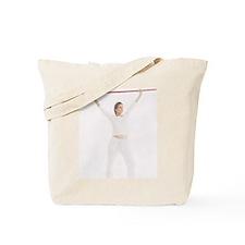 Woman exercising Tote Bag