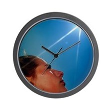 Woman's face with 'sun' Wall Clock
