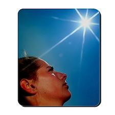 Woman's face with 'sun' Mousepad
