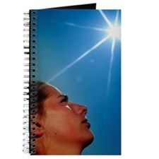 Woman's face with 'sun' Journal