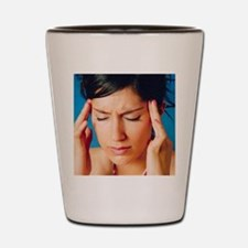Woman holding her head in pain Shot Glass