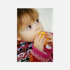 Young girl with satsuma Rectangle Magnet