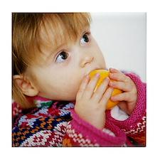 Young girl with satsuma Tile Coaster