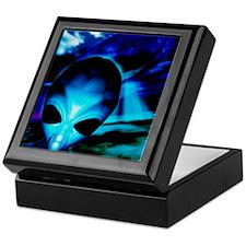 Computer artwork of an alien and a UF Keepsake Box