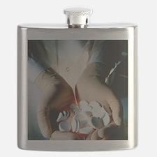 Handful of manufactured effervescent tabl Flask