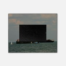 Small Sailboat Near Large Barges And Picture Frame