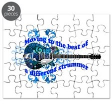 Moving To The Beat Of A Different Strummer Guitar