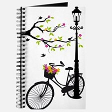Old bicycle with lamp, flower basket, bird Journal