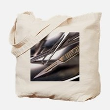 Surgical scalpel and forceps in a metal b Tote Bag