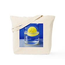 Tennis ball floating in water Tote Bag