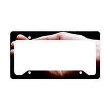 View of a hand holding variou License Plate Holder