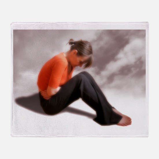 Woman holding her abdomen in pain Throw Blanket