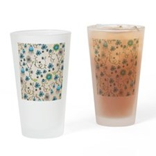 Whimsical blue flowers on beige Drinking Glass