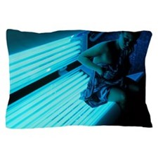 Woman getting off a sunbed Pillow Case